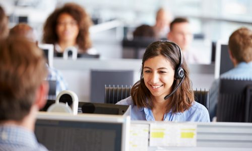 woman-working-at-call-centre-using-hosted-telephony
